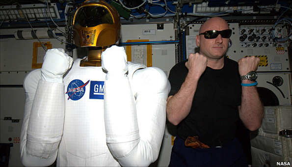 Robonaut and astronaut on station