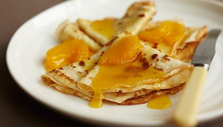 Crepes with orange butter sauce