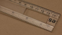 Use one half of the ruler to mark out a hole in the other half.