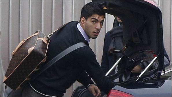 Luis Suarez arrives at Liverpool's Melwood training ground