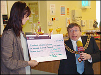 Kate and Gary Hunt with the Ruby Rainbow cheque