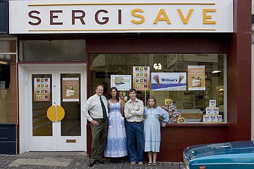Karl Sergison and his family outside the grocer's shop in the 1970s era