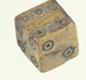 Romans, especially soldiers, liked dice games. These are Roman dice, found in London.