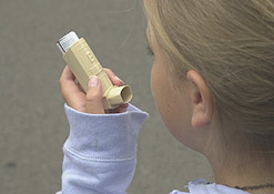 A child uses an inhalor