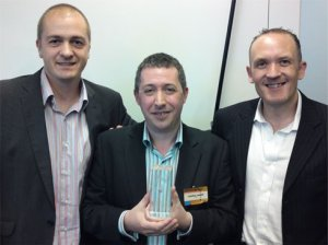 Gareth Ford Williams, Jonathan Hassell and James Hewines picking up the award