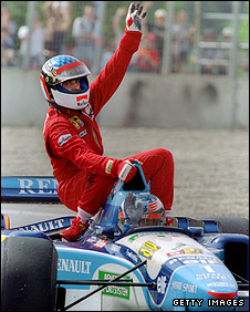 Jean Alesi gets a lift back to the pits from Michael Schumacher after the Frenchman took his only career F1 victory at the 1995 Canadian Grand Prix
