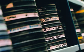 Photograph of stack of recordings on a shelf