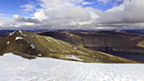 View from the top of Stob Coire Easain showing surrounding mountains and Loch Treig.