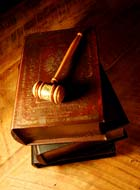 Judge's gavel and a stack of legal books. © Stefan Klein/iStockphoto