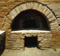 This is a Roman oven for baking bread. It is at Pompeii, the town in Italy destroyed by the volcano Vesuvius in A.D. 79.