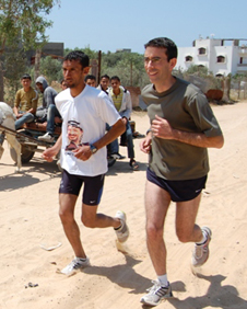 An improper runner: Tim Franks running alongside Gazan long-distance athlete Nader el-Masri