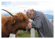 John Purser with Highland Cow