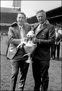 Clough and Taylor show off the Championship trophy