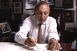 Dr Robert Gallo, showing how HIV attacks cells of the immune system.