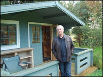 David Almond outside the shed where he writes
