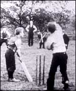 Boys playing cricket in a Bamforth film