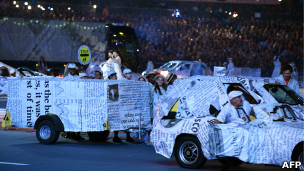 Cars wrapped in newspaper at the closing ceremony