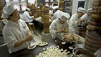 KITCHEN STAFF MAKING STEAMED CRAB DUMPLINGS IN FAMOUS 'NAN XIANG' DUMPLING SHOP. OLD CTY. SHANGHAI. CHINA © BBC/Kevin Foy