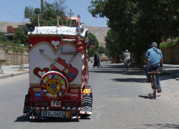 Guitars appear on dozens of Herat's motor-rickshaws