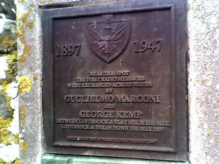 Plaque commemorating the achievements of Guglielmo Marconi and George Kemp, St Lawrence churchyard, Lavernock