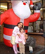 Children with an inflatable Santa.