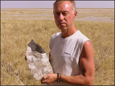 Professor David Thomas with a giant stone axe head found in dried base of Lake Mkgudikgudi