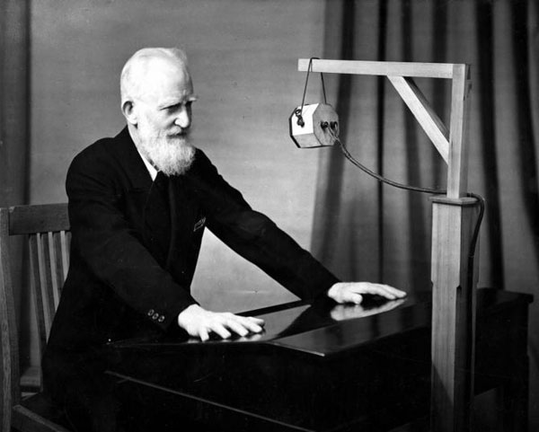 George Bernard Shaw at a microphone in 1931
