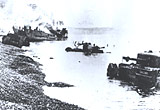 After Dieppe, tanks and craft burn on the beach, August 1942