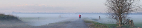 Pictiure of a cyclist in a misty landscape