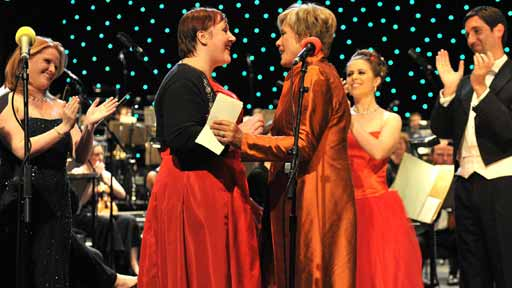 Dame Kiri Te Kanawa congratulates winner Shuna Scott Sendall on stage at the BBC Radio 2 Dame Kiri Prize Final