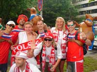 A group of polish supporters with some australians and Kangeroos