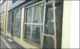 Shop windows boarded up in preparation for the hurling