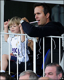 Michael Vaughan and son watching a match at Headingley