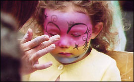 Face painting gets underway on the streets