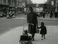 Woman and daughter in London in the 50s