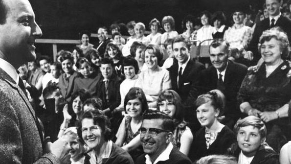 1960s TV audience laughing