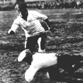 Argentina's goalkeeper Juan Botasso dives bravely at the feet of Uruguay's Hector Castro (image from empics)