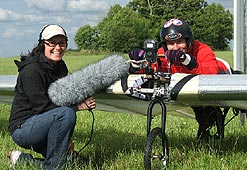 Reporter Tracey Logan with Dr Bill Brooks, testing his pedal-powered plane.