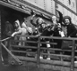 British children board a ship on their way to Canada.  People in Canada treated the evacuees as 'war guests'.