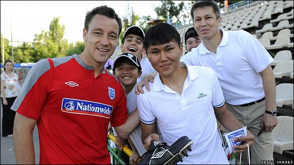 England captain John Terry meets the locals