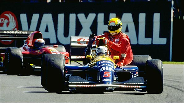 Nigel Mansell gives Ayrton Senna a lift back to the pits at the end of the 1991 British Grand Prix, as their rival Alain Prost's Ferrari follows behind