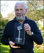 Sir Robin Knox-Johnston with his award