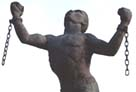 Photograph showing the statue of Bussa which represents slavery, revolt and emancipation in Barbados