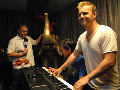 Dave and Gary enjoy a tinkle on the piano. Is that the quiz elephant in the background?
