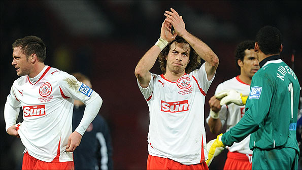 Crawley Town's Sergio Torres is applauded as the minnows run Man Utd close