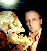 Michael Mosley with a human skull at the Parisian Catacombes as he concludes his history of surgery