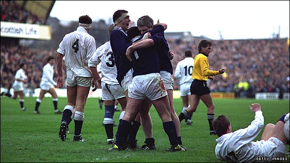 Chris Gray, David Sole and Finlay Calder celebrate 1990's Grand Slam-clinching win against England