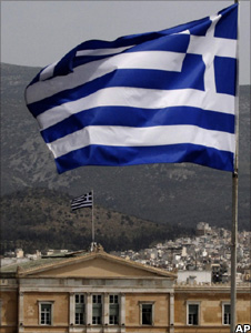 Greek flag flies from the roof of a building as the house of Parliament, Athens