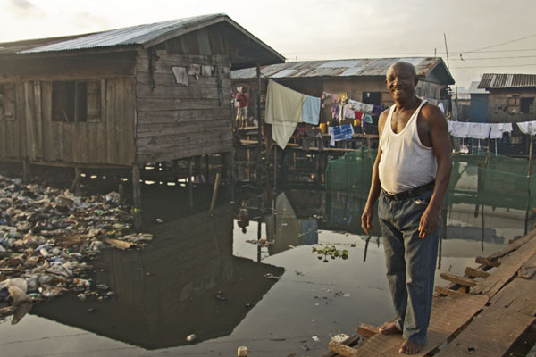 Programme two's star Mr Chubbey outside his home on the floating slum of Makoko