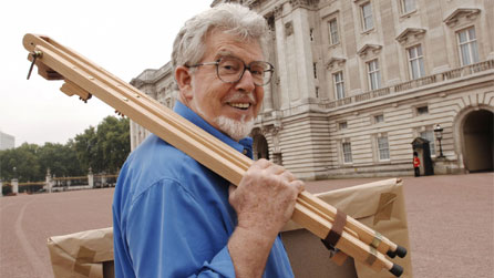 Rolf Harris outside Buckingham Palace  while filming The Queen By Rolf